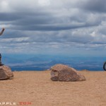 Some new riding friends all the way from Germany atop Pikes Peak celebrate their journey.