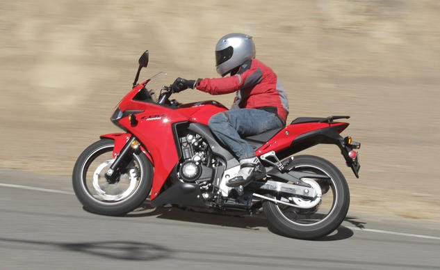 Honda's CBR500R excels where the other two fail. It has adequate power, which the 300 struggles with, and ample leg room, a big shortcoming of the 650. Its cornering performance suffers as a result, however, as hard parts touch down rather quickly.