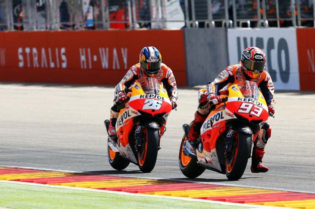 Marc Marquez's aggressive riding claimed a victim in teammate Dani Pedrosa.