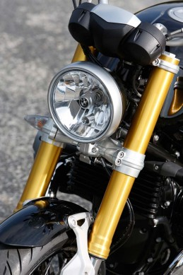 A study in contrasts: Modern gold fork, retro-styled fender strut, and a classic round headlight with a high-tech reflector.
