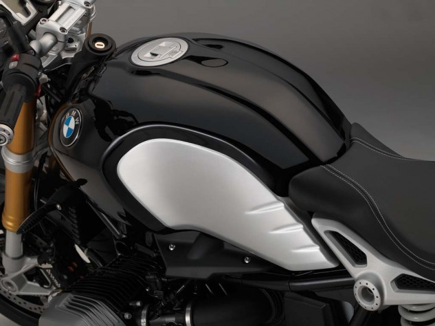 BMW motorcycles have worn classic black often during the company's 90 years of production. The silky metallic black paint creates an ideal contrast to the clear coated brushed aluminum of the tank.