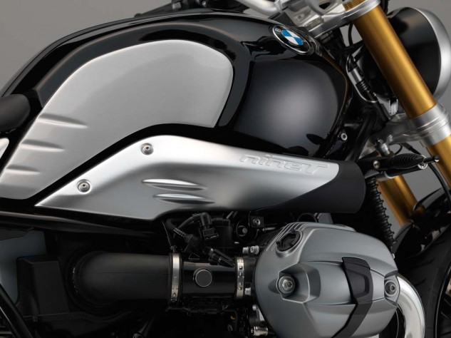 The intake ducting's brushed aluminum is embossed with nineT and some speed lines that mirror those on the tank.