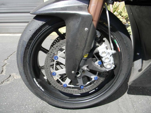 Fork tubes feature internals from Traxxion Dynamics, while Swedish firm ISR provides the six-piston brake calipers. Dunlop provides tires for the entire Moto2 category, and in this application they sit on forged magnesium Marchesini wheels.