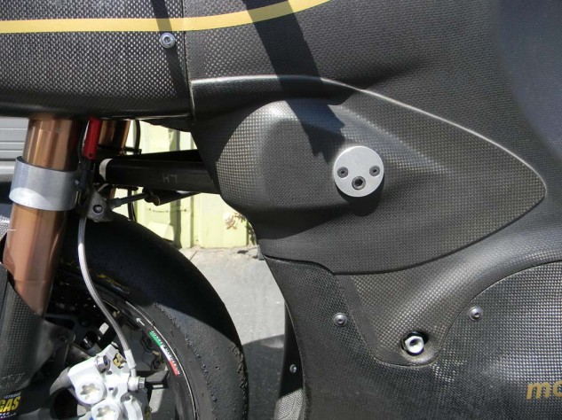 Fork dive can be controlled by the A-arm pivot angle. The plate grafted to the side of the fairing was added to extend the range of adjustability because Taylor's test rider, Shawn Higbee, had reached the limits of the original design.