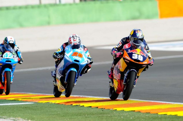 Maverick Vinales (25) emerged from a dramatic three-way battle with Luis Salom (39) and Alex Rins (42) the Moto3 title.
