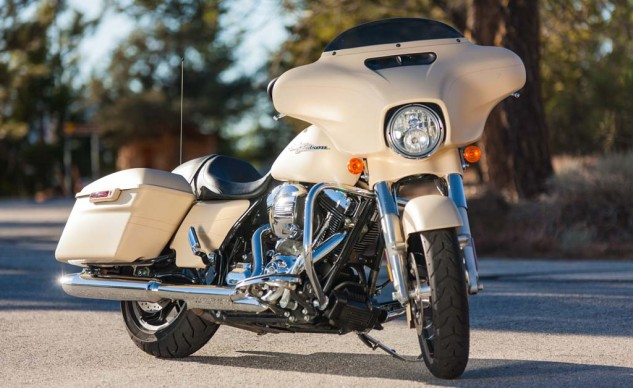 The shorty windshield on the Street Glide makes it easy to see over. The fairing vent reduces turbulence at speed.