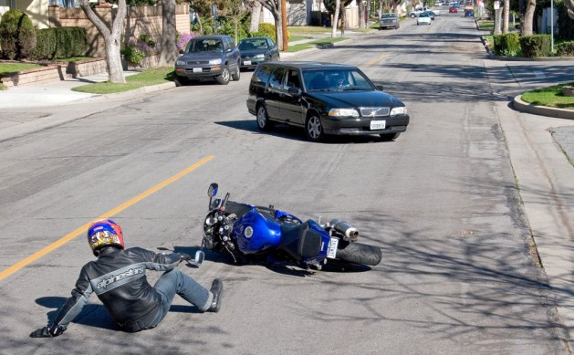 Motorcyclist Laying it Down