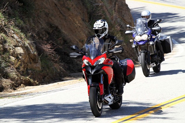 Two adventure touring bikes exiting a corner