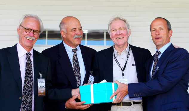 Here's Peter (second from right) at a recent Fairfield County Concours d'Elegance, being presented with a large box of currency. (The box appears too light to contain gold bars.)