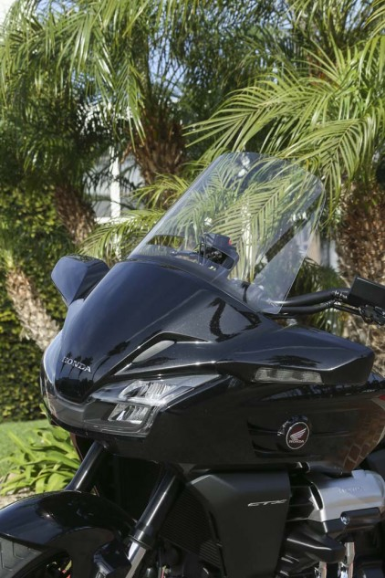 Honda outfitted a couple CTXs with the optional tall windscreen which creates a protective bubble without bothersome rear-helmet buffeting. Other accessories include a passenger backrest, rear trunk and heated grips.