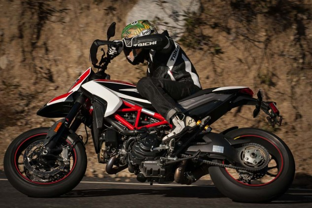The Hypermotard SP, with its endless amounts of ground clearance, is perfectly comfortable leaning over. Spending an extra $3000 for the SP over the standard will get you a trick paint job, upgraded suspension, carbon bits, forged wheels, Pirelli Supercorsa SP tires, and tweaks to the ABS and ride modes.