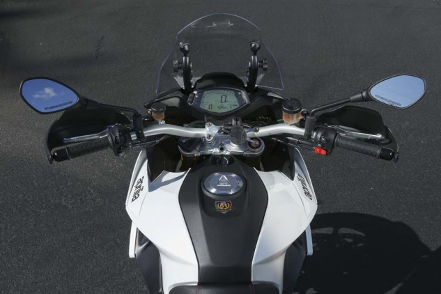 The view from the rider's seat presents a healthy 6.3-gallon fuel tank with a narrow seat junction. You're also greeted by very wide bars, an easily-viewable dash and manual windscreen. Look closely and you can also see the awkwardly placed cruise control button at the top of the right switchgear.