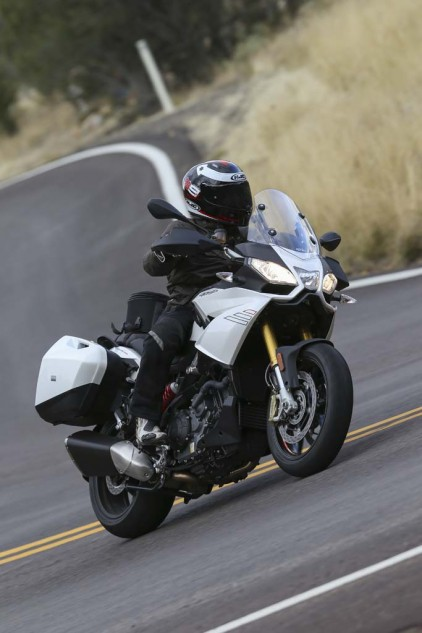 Wide bars on the Caponord help throw the 599-lb (fully fueled) motorcycle into turns. I had no ground clearance issues, but a heavier, more aggressive rider said he dragged hard parts. Note the hand guards, which lend to the A-T personality.