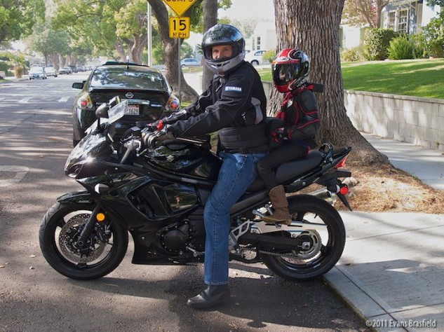 Father and daughter on motorcycle