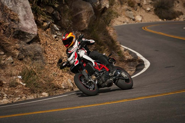 For the dirt guy looking to transition to pavement, the Hypermotard might be more familiar due to its height and narrow profile.