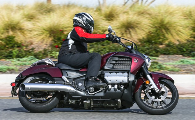 The relocated pegs combine with the 19-inch front and 17-inch rear wheels to give the 2014 Valkyrie some pretty impressive ground clearance. The Dark Red Metallic feels more stately than the other colors.