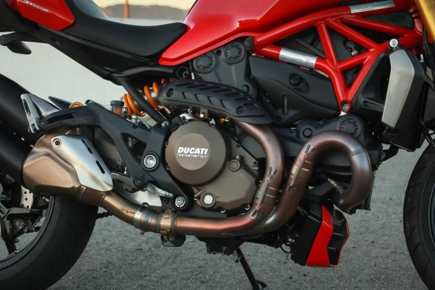 Ducati should direct some Italian design and taste towards the left side of the engine where the ugly hoses and the water outlet resides.