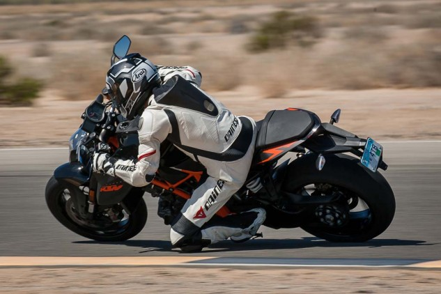 That poor back tire is wholly incapable of coping with the KTM's uh, whevos grande! Of course that just makes it even more fun to ride when you're just playing around on track... think motocross bike on a beautifully-groomed golf course.