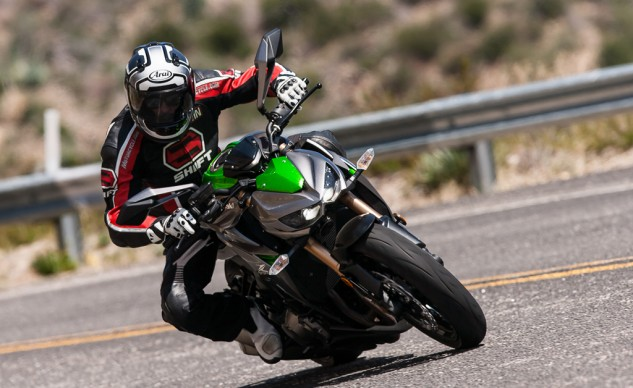 Thoroughly refreshed for 2014, Kawasaki's avant-garde Z1000 was designed to place its rider in an upright but aggressive riding position that, when coupled with its unusually low headlight nacelle, creates the illusion of a disappearing front-end.
