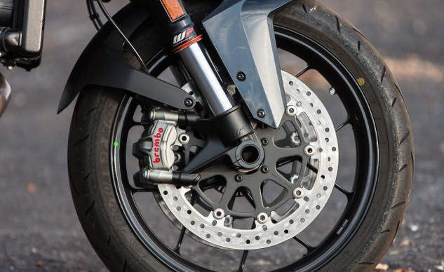 "Although the KTM and Ducati wear the same front Brembo M50 Monobloc calipers with the Ducati gripping 330mm discs and the KTM 320mm discs, Burns felt the KTM provided better stopping power. ""The KTM's superior ergos make it a more confident braker to me, even if the hardware is the same. Higher bars, feet in a better place, nicely shaped tank to clamp thighs upon, no?"""