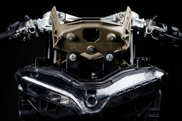 Ducati's Panigale uses magnesium for its upper fairing bracket, a structure that supports the upper fairing, headlights and gauges while weighing just 1.3 pounds.