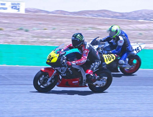 Former National Speedway champ Billy Hamill slips his Honda past Xen Stanhope's Ducati on the way to victory in Battle of the Twins Formula 3. Hamill also won the CB160 race and 200 GP.