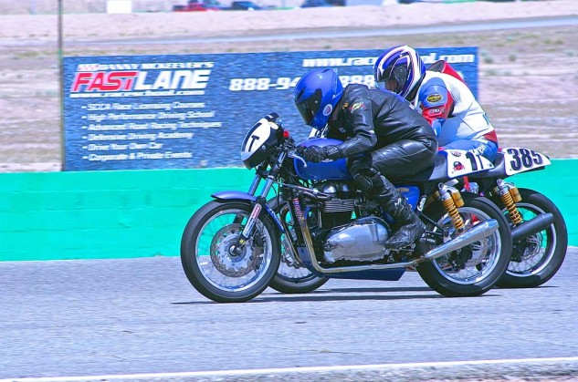 Jerrett Martin (1t) and Fred Willink battle on the front straight in the Thruxton Challenge class.