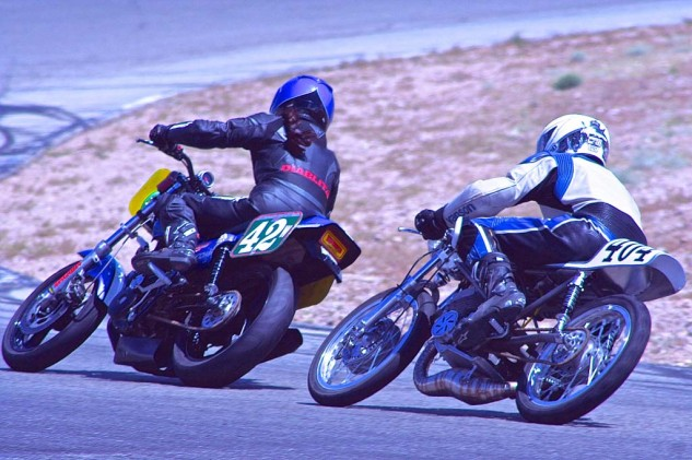 Wendy Newton is trailed into Turn 4b by Jeff Henise on a '68 Kawasaki.