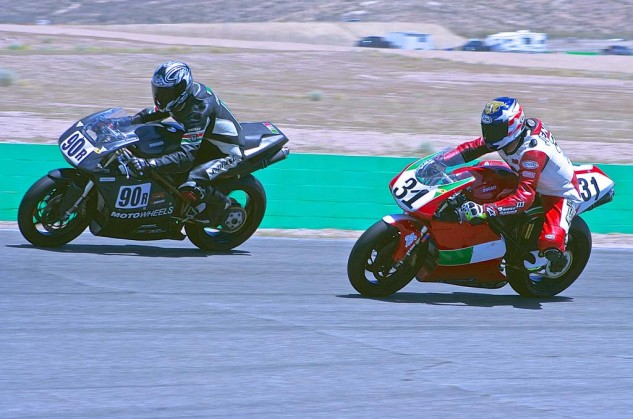 Paul Vogel (90r) and Scott Jennings go into Turn 1 in the Battle of the Twins Formula 1 race.
