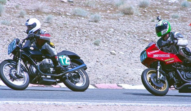 Ed Milich (947) sets up to put his Ducati in front of Pete Homan's BMW to win the Vintage Superbike Middleweight event.