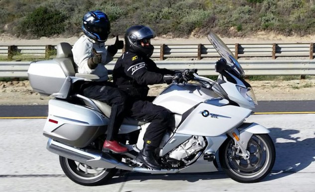 "The K1600 GTL Exclusive's passenger accommodations gets two thumbs up from Duke's wife, Carolyn. ""It's a luxurious motorcycle ride,"" she says. ""And the heated seats; total bonus!"" With the windshield in its uppermost position as seen here, airflow over both rider and passenger is smooth, with no annoying backpressure."