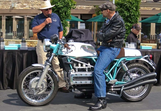 "Evan Bell (left), owner of Irv Seaver Motorcycles in Orange, Calif., commissioned   Larry Romestant to build a custom BMW for the dealership's 100th anniversary. The ""Bell Kaff"" is a nod to the cafe racers of the 70s, using an '04 K100 RS engine and drivetrain. Bell saw the motorcycle for the first time at the event. He was impressed."