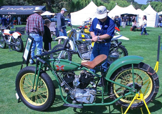 Competition class Judge Richard Yamane looks over a rare 1930 Excelsior factory hillclimber entered by Bob and Linda Primmer.