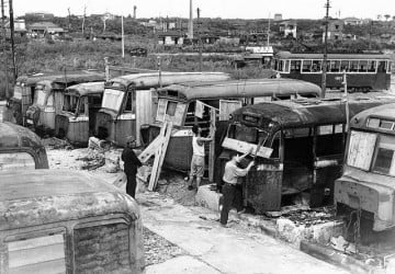 Homeless Japanese citizens hauled these bus carcasses into a makeshift community and converted them into family abodes during the severe housing shortages in the aftermath of the U.S.' firebombing of the Japanese mainland near the end of WWII. (AP Photo/Charles Gorry ©1946)