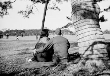 An American G.I. places his arm around his Japanese girlfriend in Hibiya Park during the post-war reconstruction period. (AP Photo/Charles Gorry ©1946)