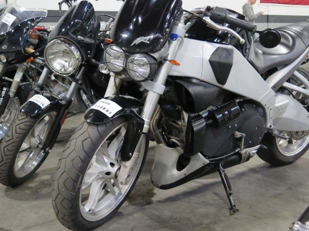 I almost wanted this Buell XB9S, which sold for $3400, but wasn't crazy about some of the mods inflicted upon it. My son's dying for a Harley; I thought about buying him the never-titled Buell Blast, but decided I'm not that cruel a father.