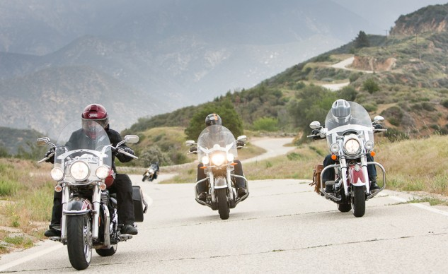 Four leather baggers on a mountain road