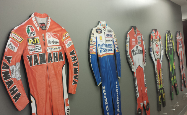 Dainese Italy has a vault full of leathers dating back to the company's earliest days. Here, we get cardboard cutouts instead. Can you match the leathers to the rider?