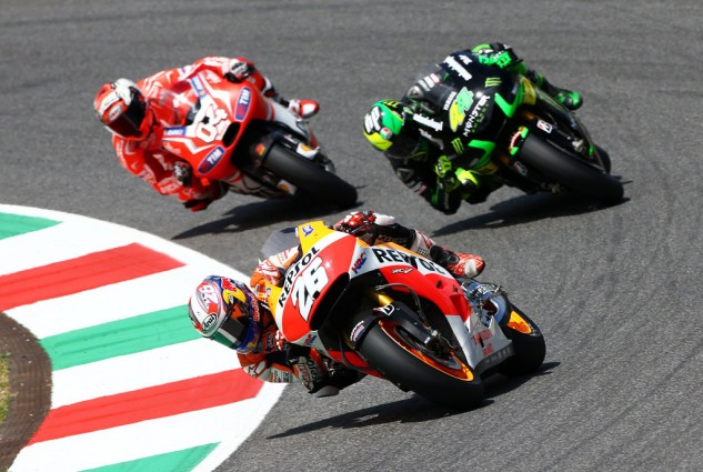Dani Pedrosa prevailed in a battle against Pol Espargaro and Andrea Dovizioso.