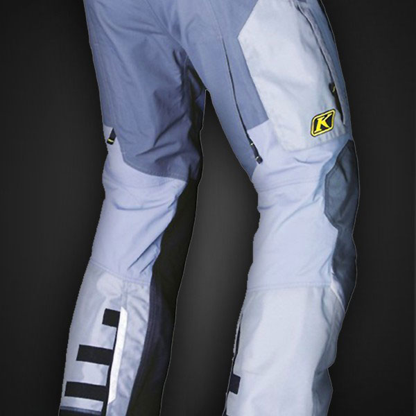 The Overland Pants in grey. Note the adjustable cuffs, leather wear protection on the inner, lower leg, and the rear, vertical exhaust vent.