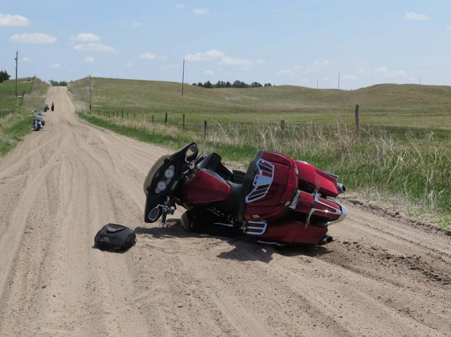 Absolutely no one could have predicted this. Maybe don't pack so many fossils and bottles of Arkansas port if you plan to ride in sand? Luckily, some Colorado grandmothers on Harleys were there to help me pick her up. Good crash bars limited damage to light scrapage on the left lowers.