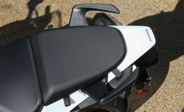 Convenient web loops attached to the pillion make it easier to strap items down.