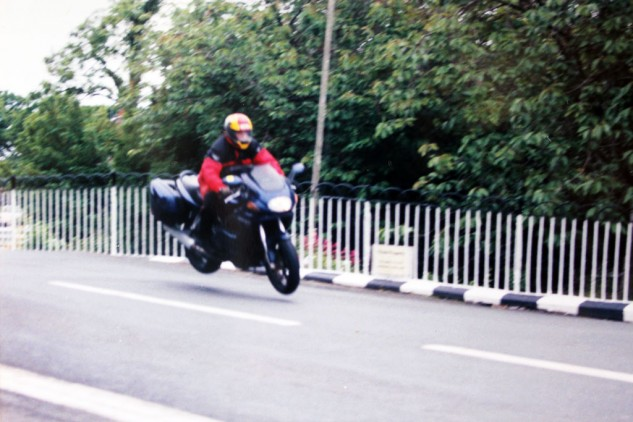 "Duke on a Duc jumping Ballaugh Bridge at the Isle of Man. The races are held on public roads, which are made accessible before and after each days racing, so spectators are able to ride the race circuit. This shot was taken in full view of a policeman who, when asked by my buddy if he could take a picture of me jumping over the bridge, said, ""There are two things. If you crash, you crash. And if you crash, we'll write a ticket."" The IoM is also notable for not having speed limits outside of towns."