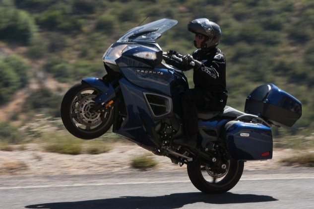 A few bricks in the 55-liter trunk makes the Triumph even easier to wheelie.