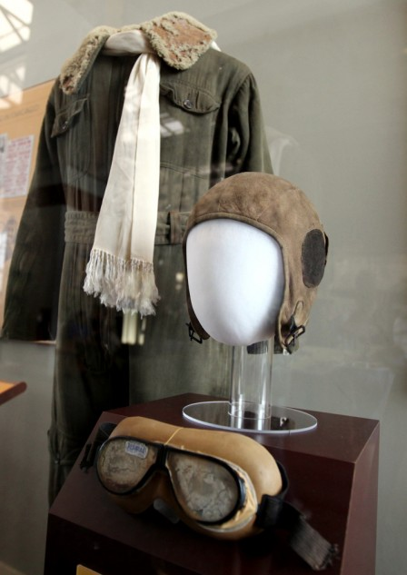 Early aviators and motorcyclists wore the same uniform; silk scarf, goggles and leather helmet.