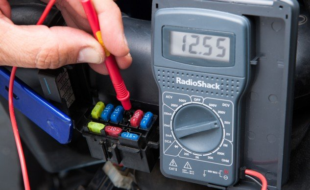 You don't need a fancy voltmeter. You're just trying to learn which side of the fuse box is hot.