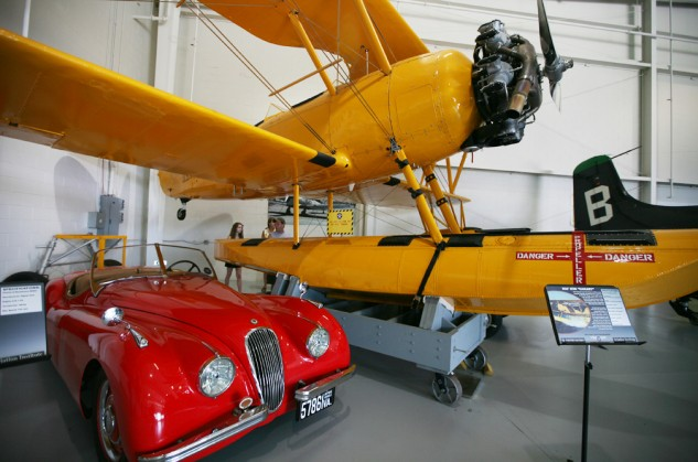 A gearhead's paradise: a 1950 Jaguar XK120 and a N3N-3 Canary seaplane on display at the Military Aviation Museum.
