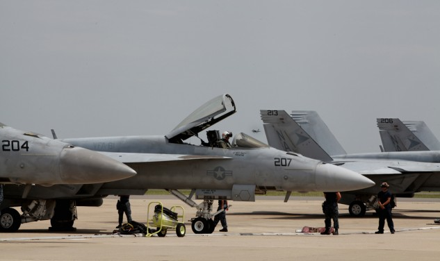 The pilots of VFA-81 prepare to launch their Super Hornets. Navy pilots who fly and ride say the experiences are similar.