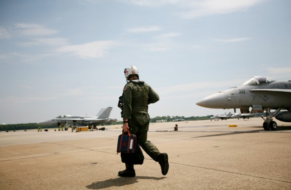 "Photo by Holly MarcusA VFA-81 pilot heads to ""the office."""