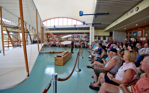 A park ranger explains how the 1903 Wright flyer worked to a crowd at the Wright Brothers National Memorial.